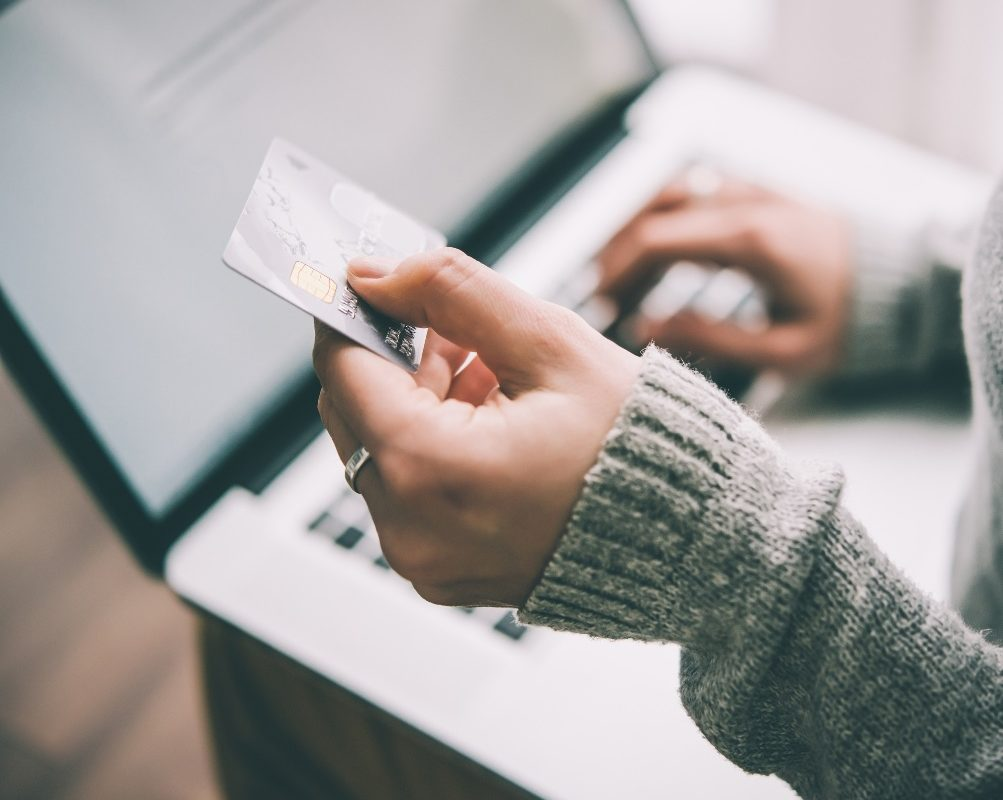 Picture of a woman paying online using a credit card