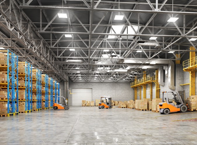 Fork lifts in a big warehouse facility full of inventories