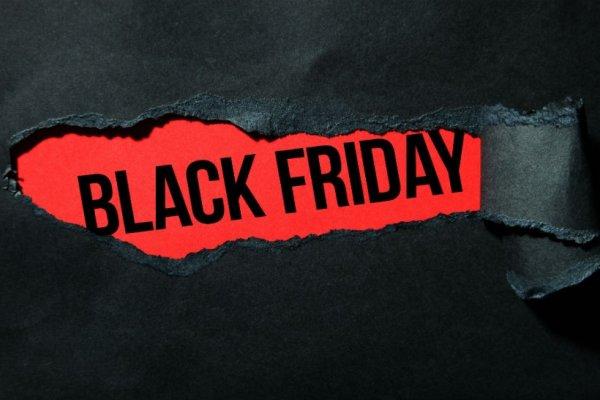 Ripped black paper revealing black friday