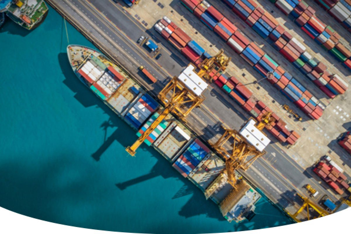 Aerial view of a cargo sea port full of metal container