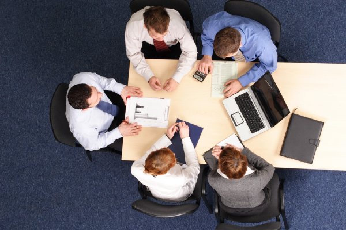Top view of businessmen in a meeting in an office