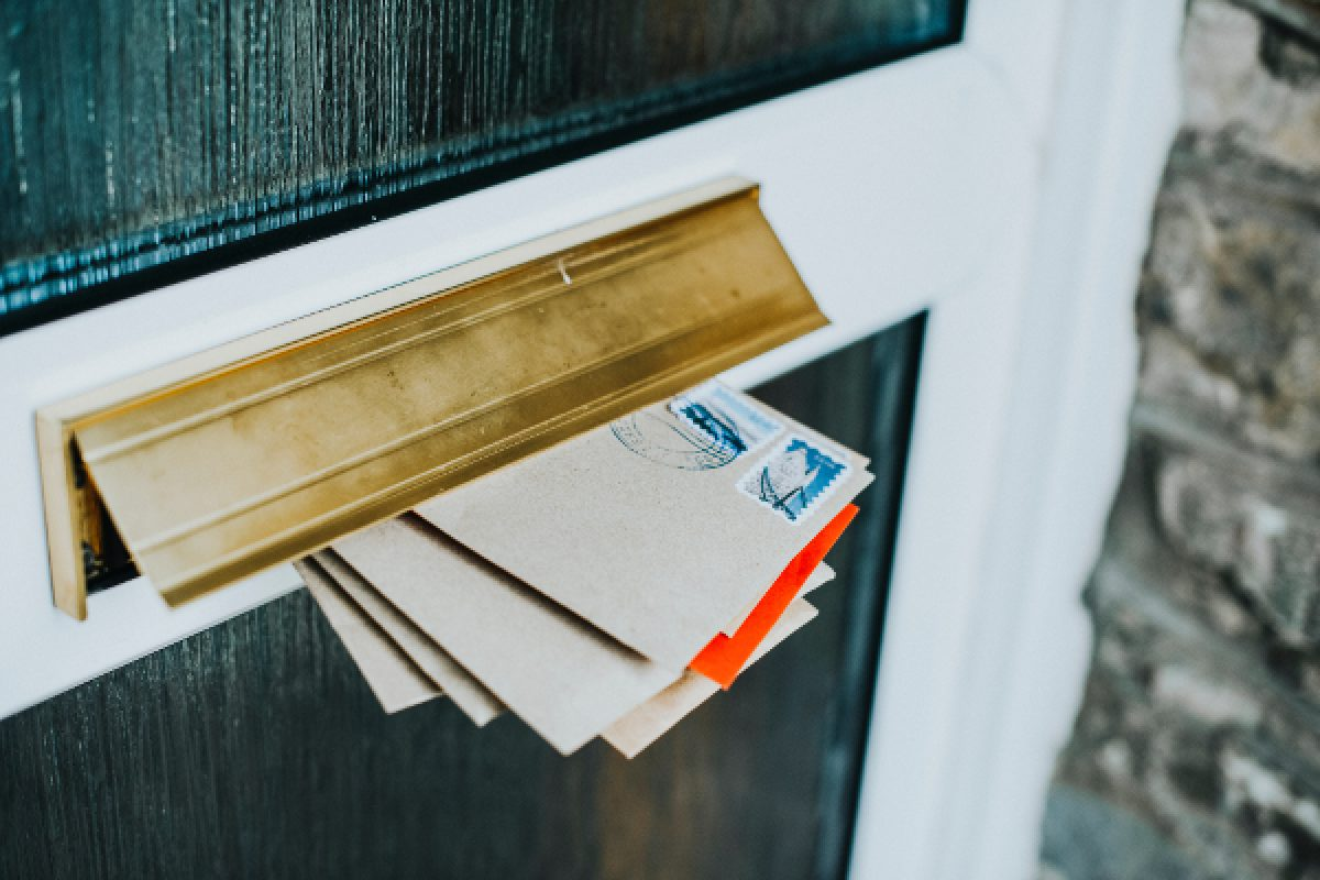 Mail hanging out of a door's post opening