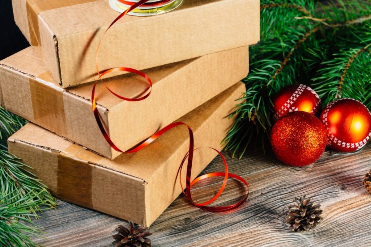 Picture of boxes beside Christmas ornaments